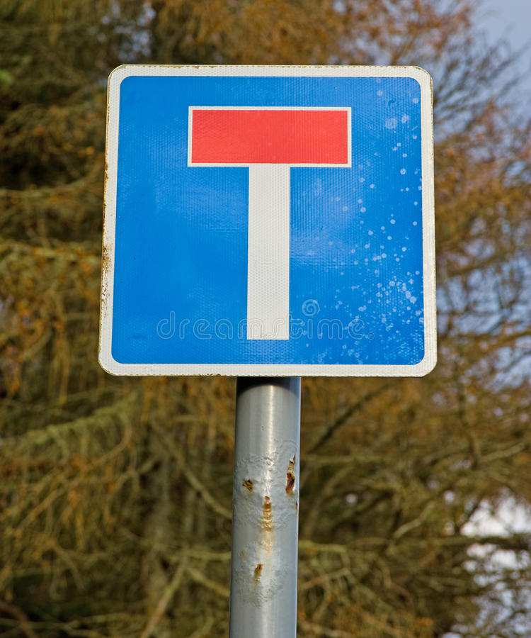 Sign indicating road with a dead end. An image of a road sign splattered with salt and on a rusting pole indicating a dead end or no through road royalty free stock images