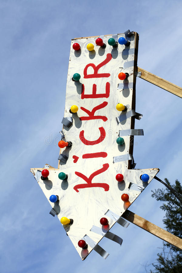 Sign Kikcker. & x28;Football player in German& x29; with electric light bulb royalty free stock images
