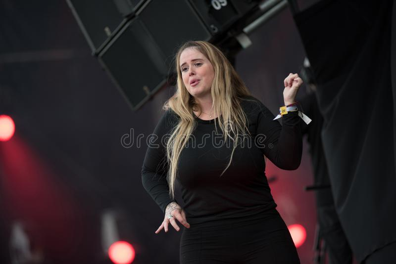 Sign language interpreter at concert. BONTIDA, ROMANIA - JULY 18, 2019: Sign language interpreter translating a song for persons with hearing impediment at royalty free stock photo