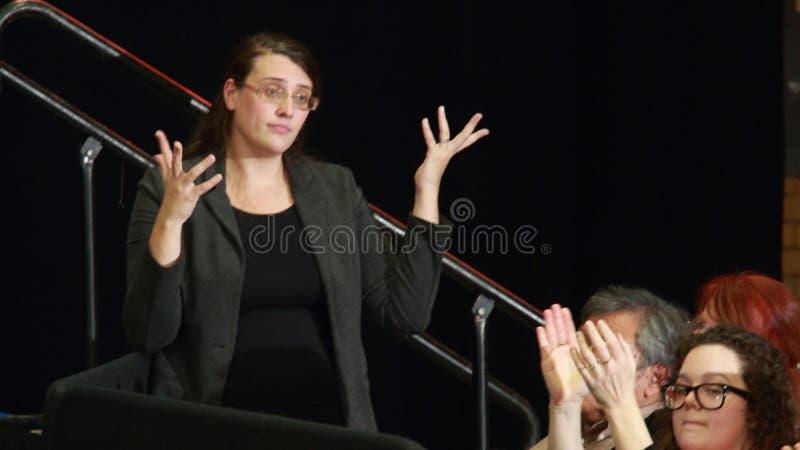 Sign Language interpreter. DECEMBER 15, 2015-MOUNT VERNON, IOWA Interpreter signs as Bernie Sanders speaks at rally at Cornell College stock photography