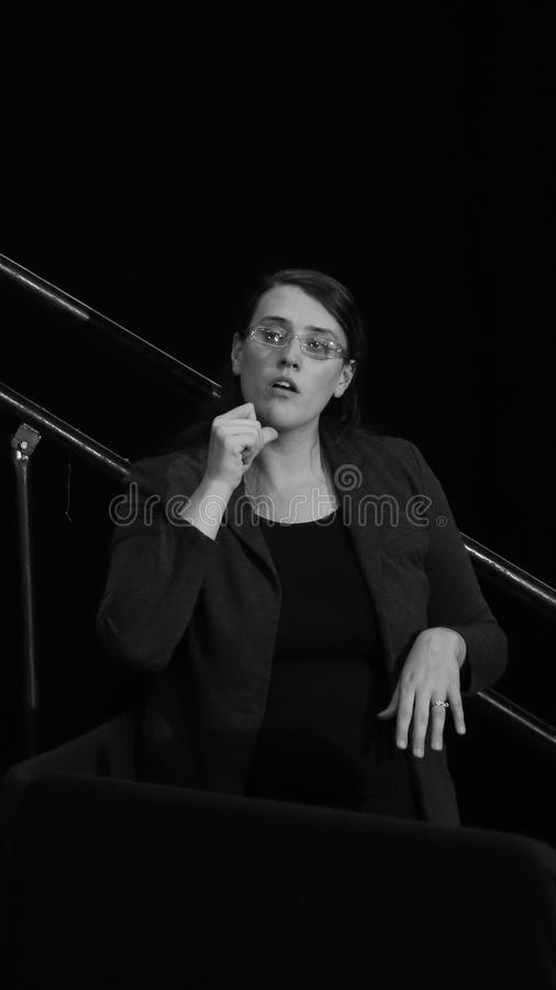 Sign Language interpreter. DECEMBER 15, 2015-MOUNT VERNON, IOWA Interpreter signs as Bernie Sanders speaks at rally at Cornell College. Black and white royalty free stock images