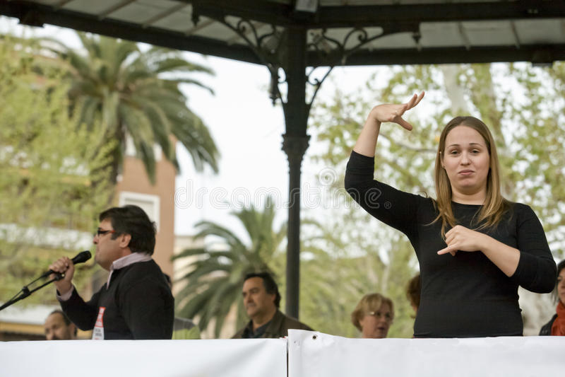 Sign language woman interpreter gestures during a meeting. Badajoz, Spain - March 29, 2012: sign language woman interpreter gestures during a meeting that royalty free stock photo