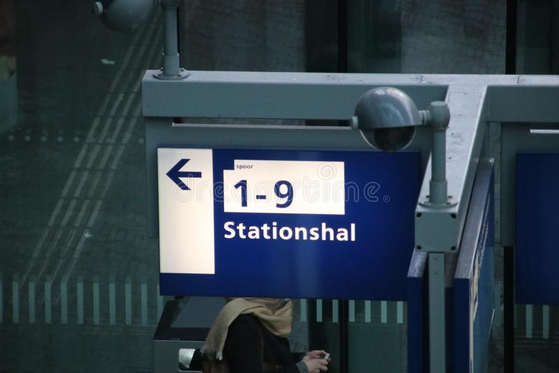 Sign leading to the platforms of train or metro on den Haag centraal station in the Netherlands stock photos