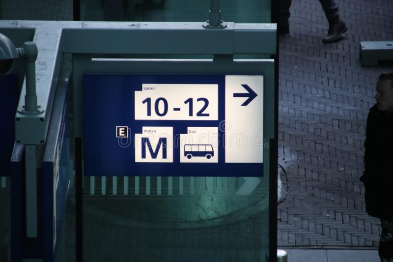 Sign leading to the platforms of train or metro on den Haag centraal station stock images