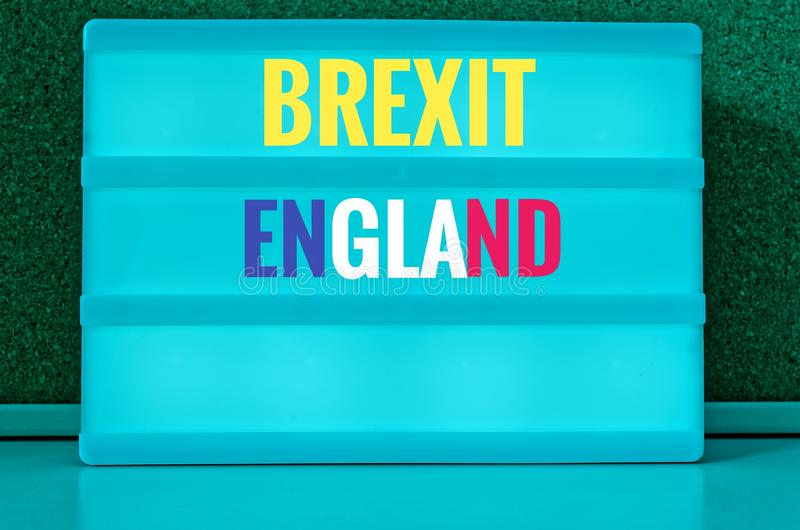 Sign with light inscription in German Brexit, England, Northern Ireland, Wales and Scotland in English Northern Ireland, Scotland,. Wales symbolizing the stock image