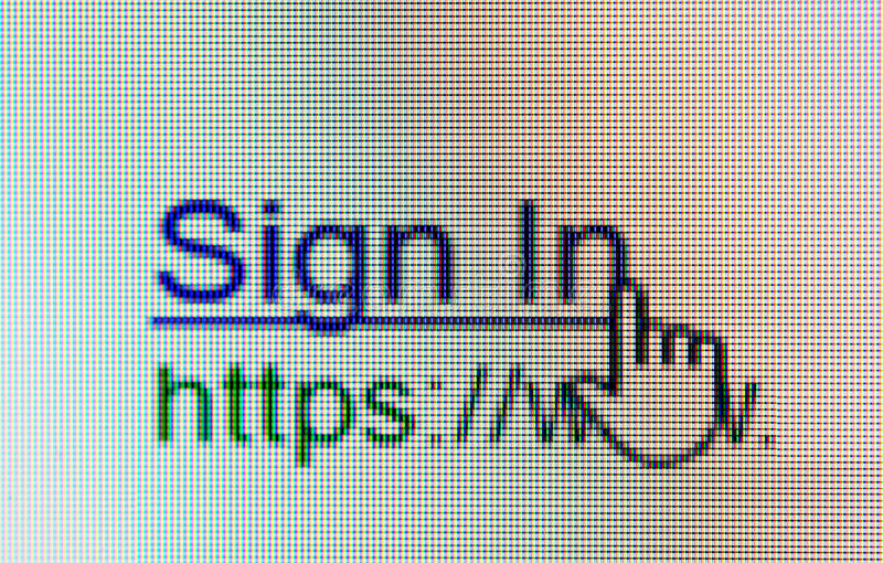 Sign in Link with Mouse pointer. On Monitor computer stock photography