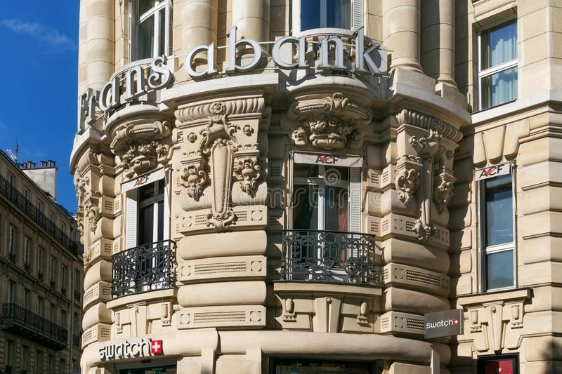 PARIS, FRANCE - JUNE 23, 2017: A sign with the logo Fransabank on one of the historical buildings in the center of Paris. A sign with the logo Fransabank on one royalty free stock images