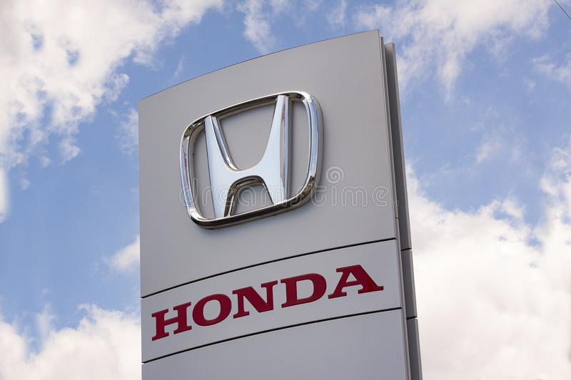 Sign with the logo of Honda Motor Company, Ltd. Japanese public multinational automobile brand. royalty free stock photos