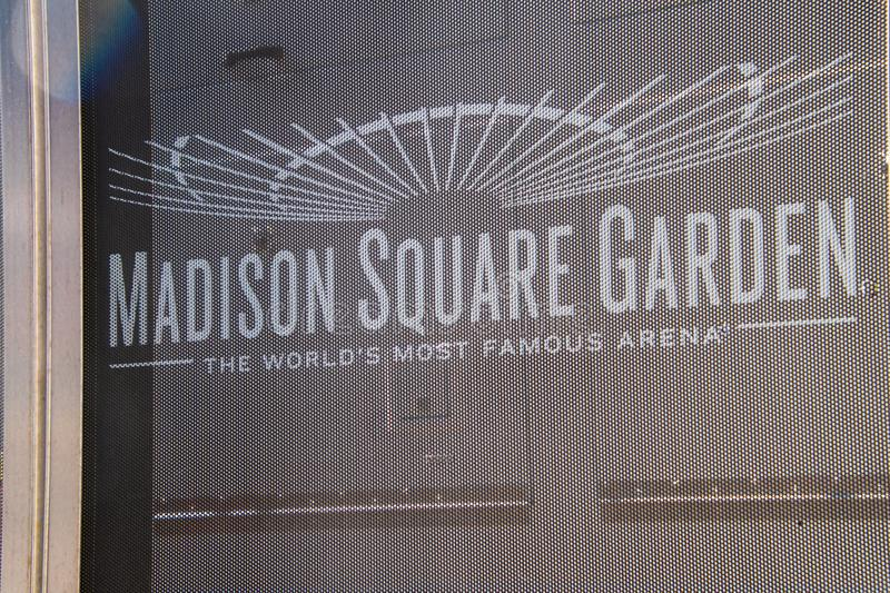 Sign for Madison Square Garden on a mesh curtain blocking the construction at this site stock images