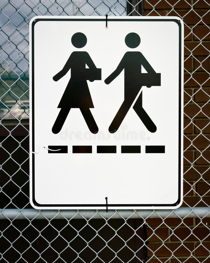 Download Sign - Man And Woman Walking With Briefcases Stock Image - Image: 21611001