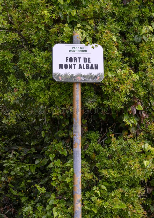 Sign for Mount Alban Fort, between Nice and the bay of Villefranche, France. Pictured is a sign for Mount Alban Fort in Parc Du Mont Bron.  It is located at the royalty free stock images