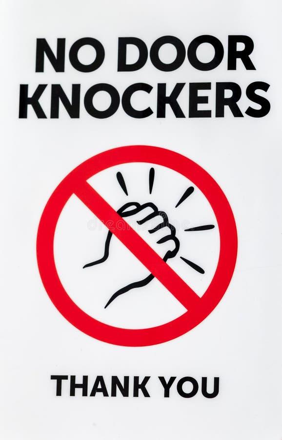 Sign: NO DOOR KNOCKERS THANK YOU stock photo