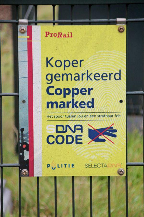 Sign no trespassing and copper marked at railway tracks to prevent theft and walkers along the track. Sign no trespassing and copper marked at railway tracks to stock photography