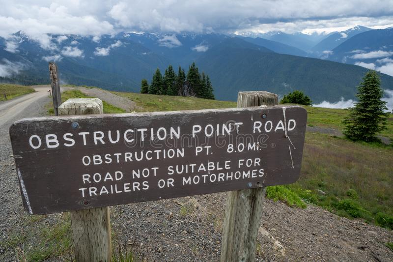 Sign for Obstruction Point Road in Olympic National Park, as seen from Hurricane Ridge. Not suitable for trailers and RVs stock images