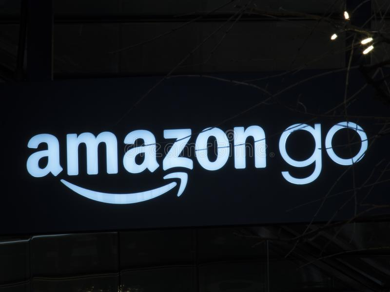 Sign outside Amazon Go convenience store that requires no check out cashier opened their first store near Amazon campus stock images