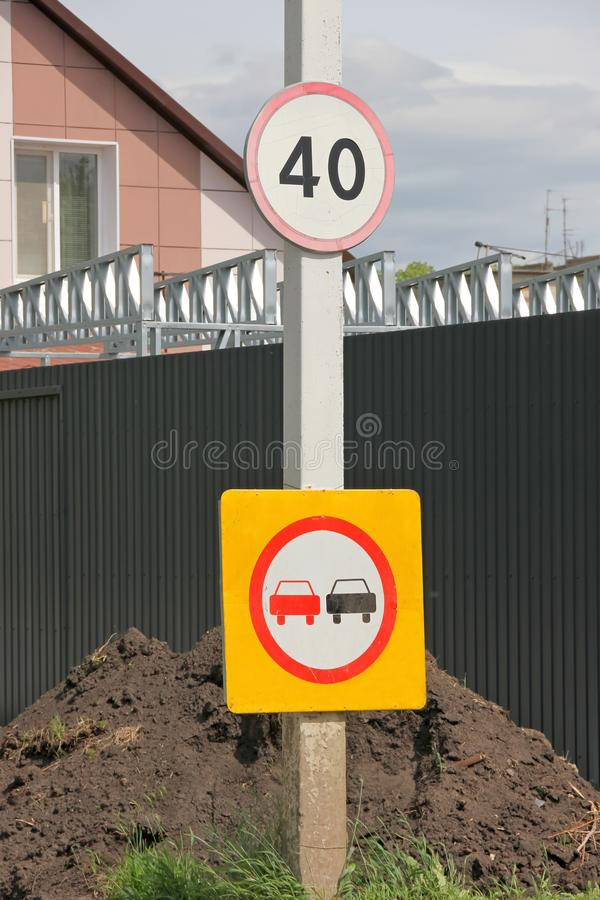 Sign Overtaking is prohibited and 40 in a red circle on a pole. On a black background royalty free stock photography