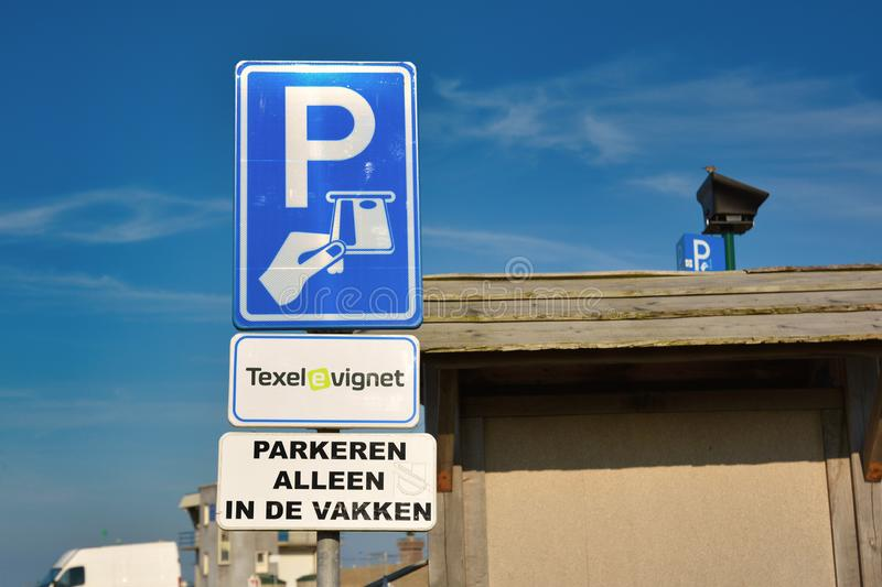 Sign at parking space on island Texel allowing free paking if a `Texel e vignet`, a digital parking card, was bought stock photography