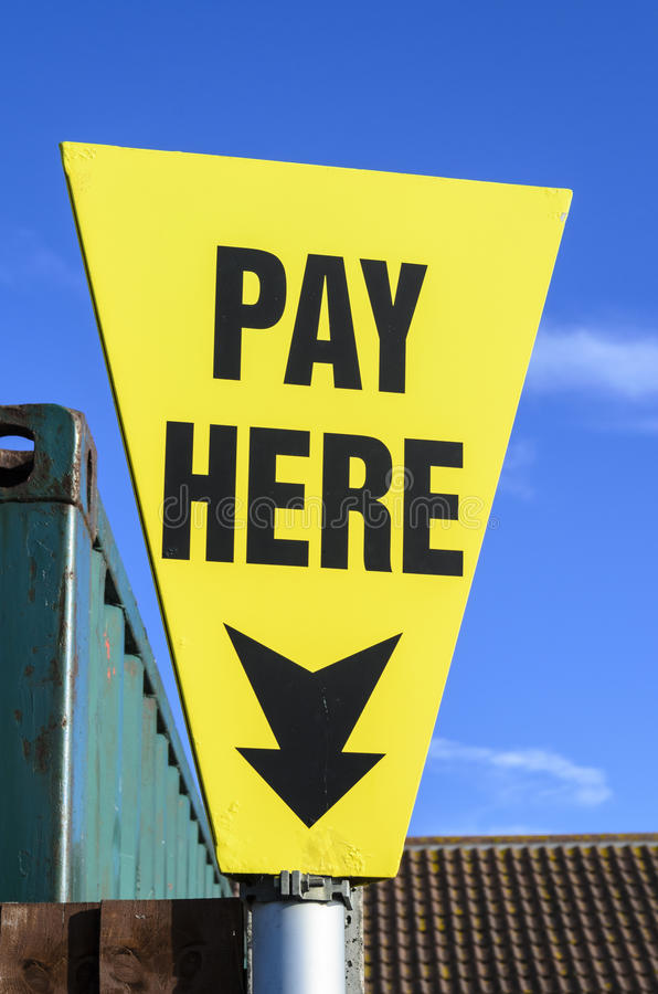 Sign pay here stock photo