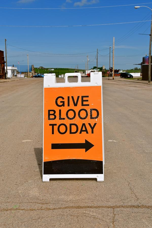 A sign on the street encouraging the giving of blood royalty free stock image