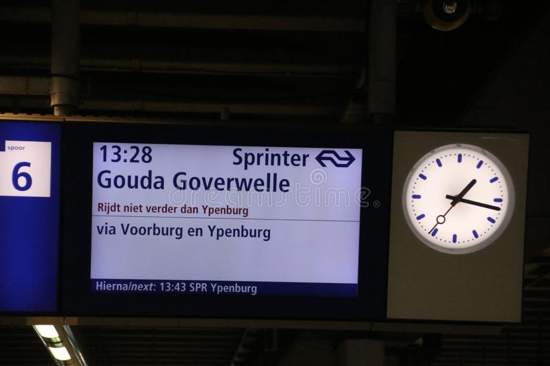 Sign on platform at Den Haag Centraal station that train to Gouda won `t drive further . stock photography