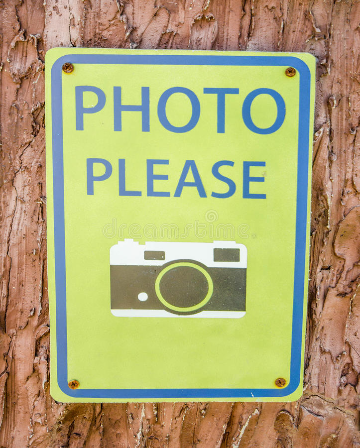 Sign of please take photo. On tree background royalty free stock photography