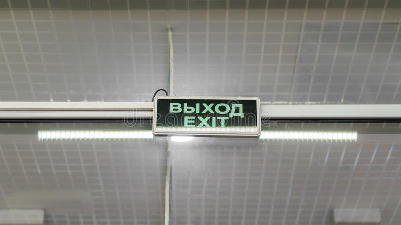The sign of the pointer Output on the ceiling. The sign of the output pointer on the ceiling of a large shopping centre royalty free stock photography