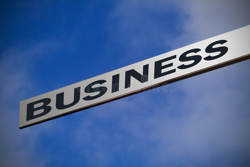 Sign pointing to BUSINESS royalty free stock image