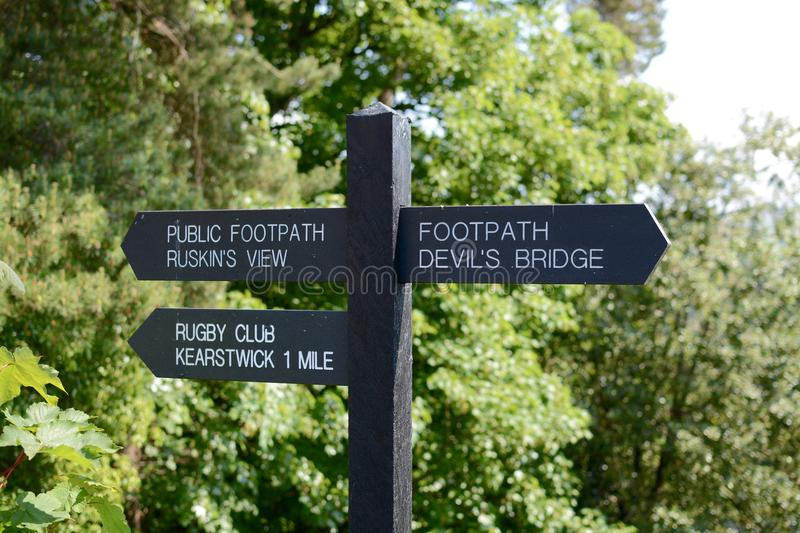 Sign post. A finger post sign at Kirkby Lonsdale showing directions royalty free stock photo