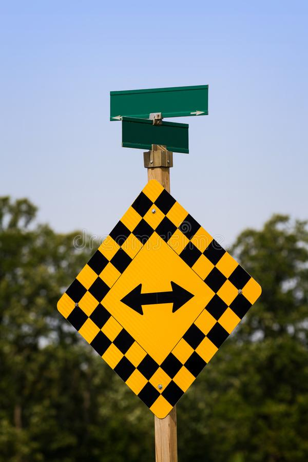 A sign post indicating a which direction to go with road names left blank royalty free stock photos