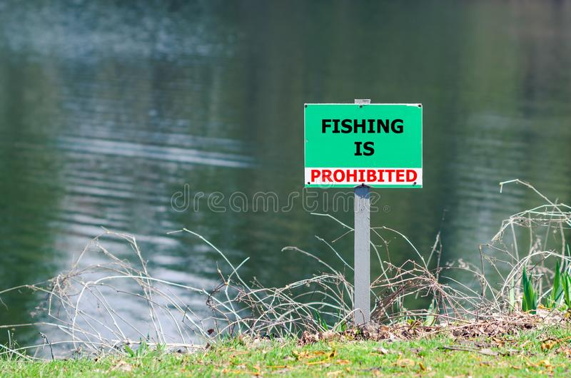 A sign prohibiting fishing in the pond.  stock image