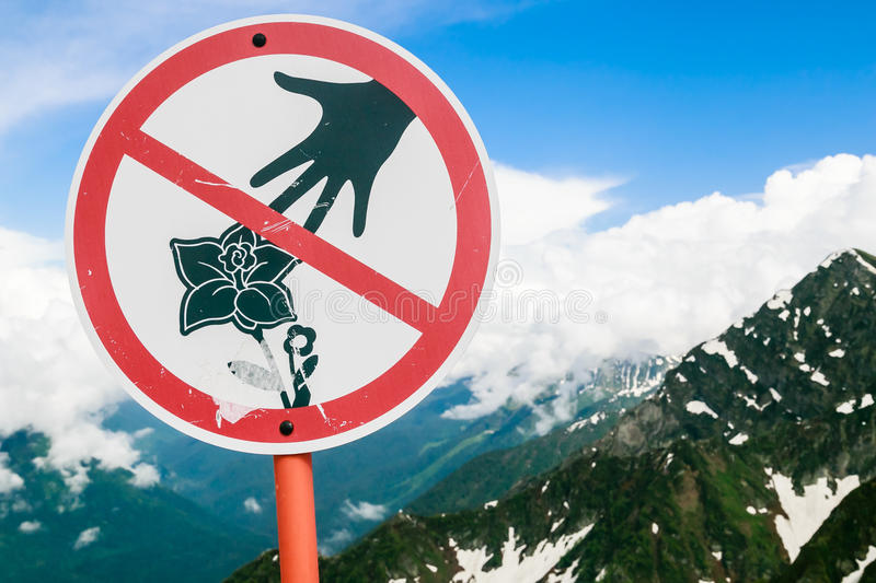 Sign prohibiting pick flowers in the mountains. Ski resort . Sochi. Russia royalty free stock photo