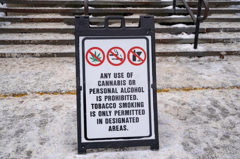 Sign prohibiting the use of cannabis, alcohol and tobacco smoking. Winter scene with snow.  royalty free stock photography