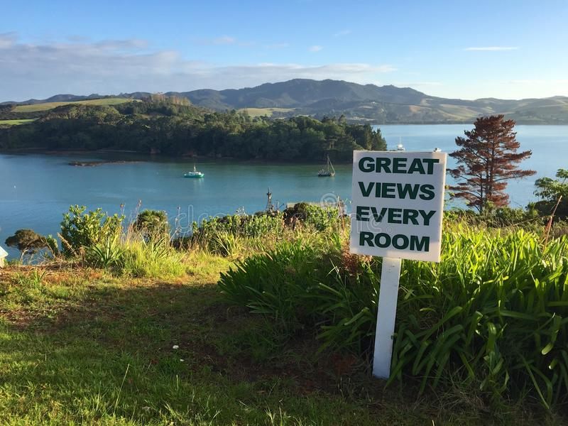 Sign promoting tourism in Mangonui Harbour, Northland, New Zealand. A sunny summer day in Doubtless Bay in the New Zealand region of Northland. The water is a royalty free stock photography