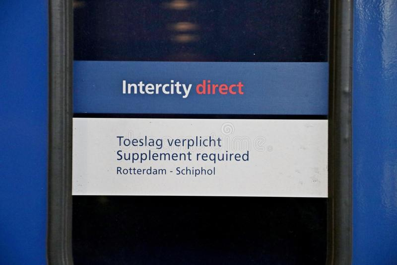 Sign on railroad platform to warn to pay for surtax or supplement on the fee to travel with the intercity direct on Rotterdam Cent royalty free stock images