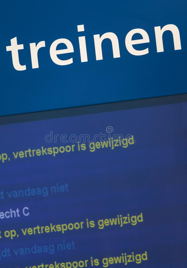 Sign on a railway station with the Dutch text stock photos