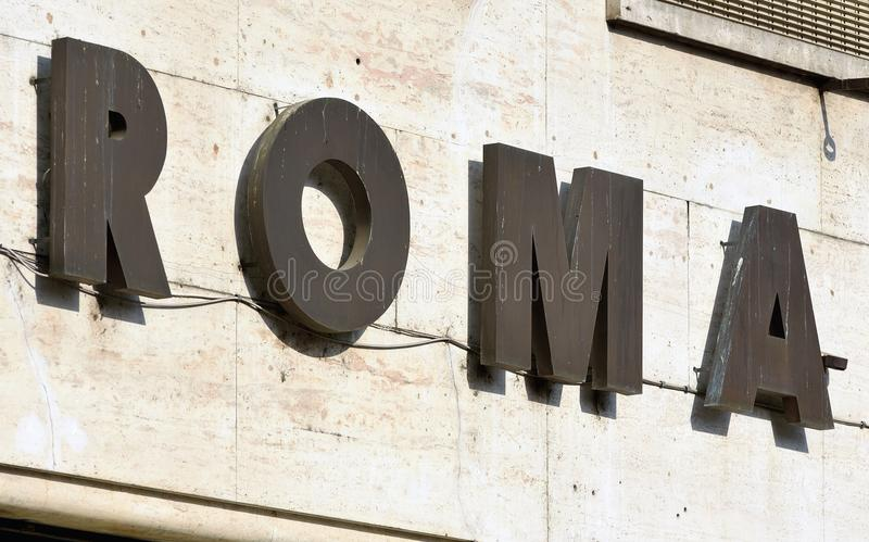 Sign reading 'Roma', Rome, Italy. Sign cropped to spell out 'Roma', taken in Torre Argentina, Rome, Italy royalty free stock image