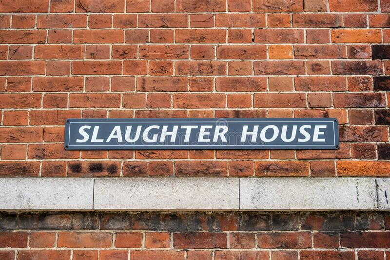 A Sign reading Slaughter house on a brick building royalty free stock image