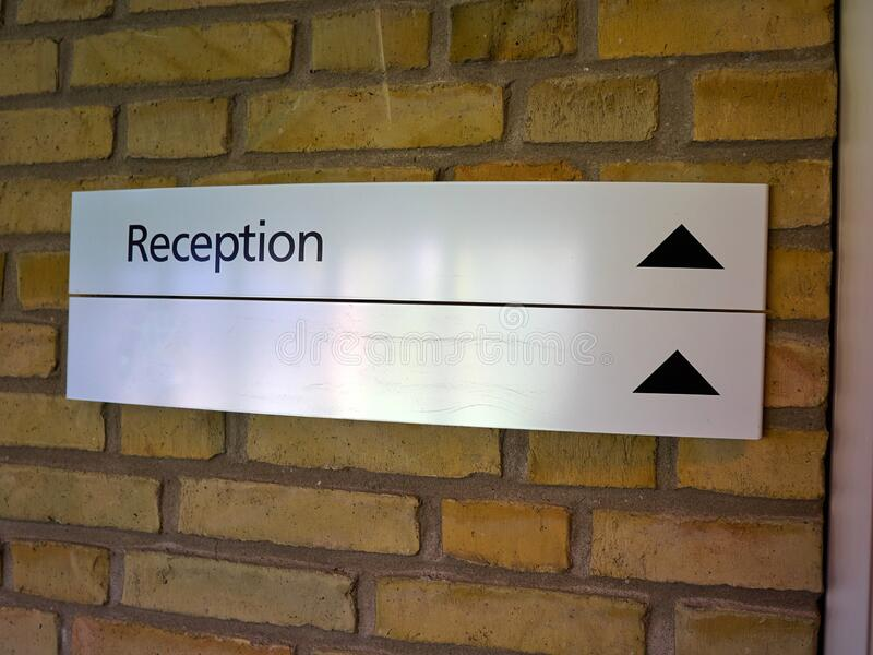Sign of a reception area on a wall royalty free stock image