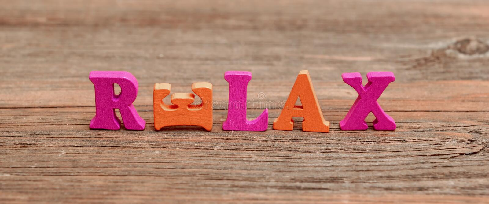 Sign Relax on the wood board royalty free stock image