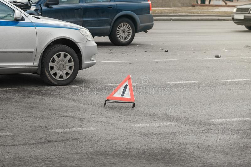 The sign on the road warning of the accident. The sign on the road warning about the accident. The scattered parts and fragments after the accident royalty free stock images