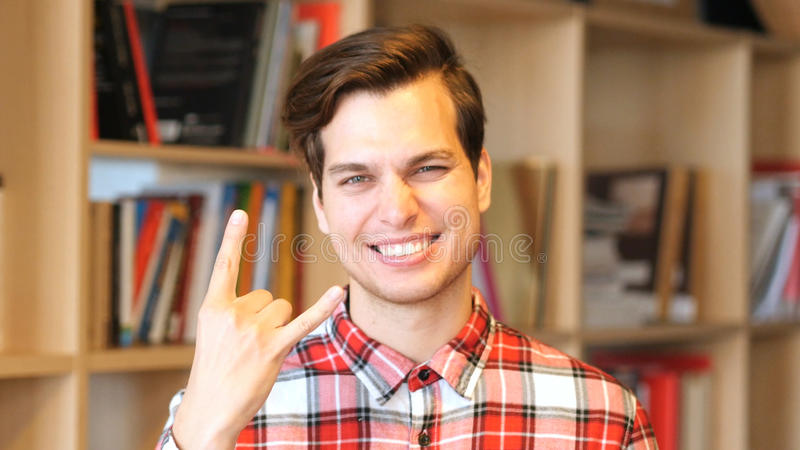 Sign of Rock, Excited young Man royalty free stock photography