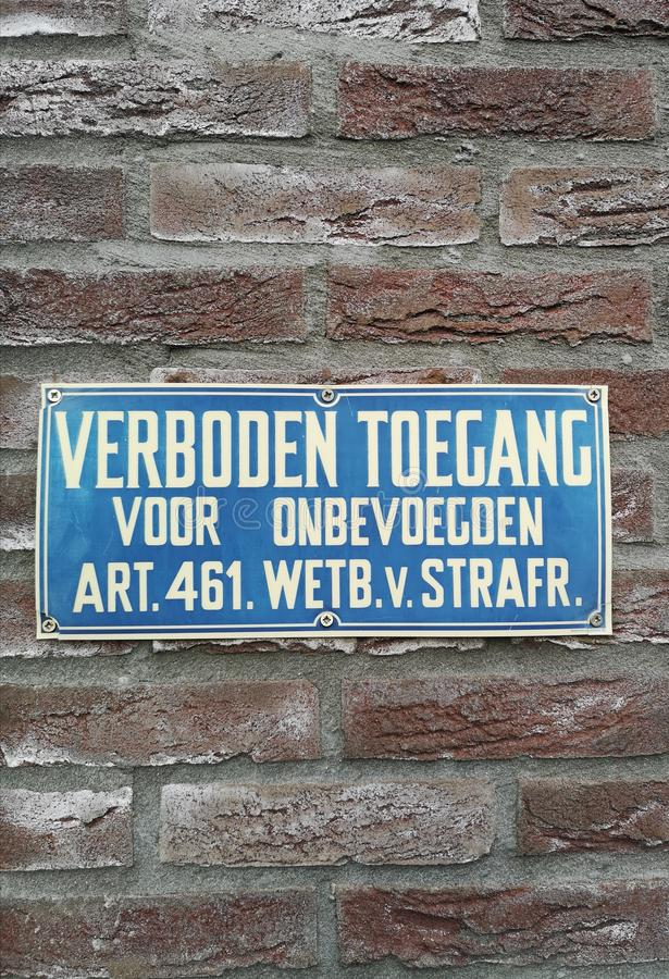 Sign saying in Dutch that access is not allowed for unauthorized people. A close-up of a sign saying in Dutch that access is not allowed for unauthorized people royalty free stock photography