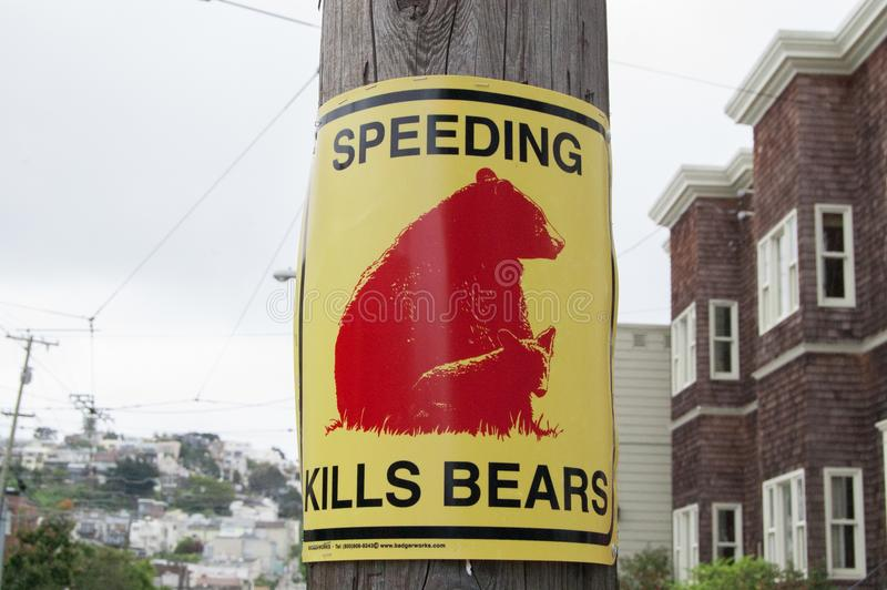 Sign says SPEEDING KILLS BEARS on the street of San Francisco, America. Street signs means the traffic rule, advertising, or many. Things. In summer time royalty free stock photos