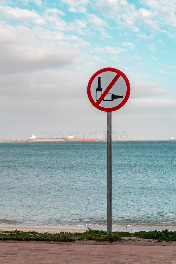 Sign by seaside prohibiting the use of alcohol. Ic drinks royalty free stock photos