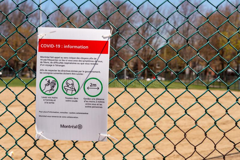 Sign showing Covid-19 safety guidelines in Montreal. Montreal, CA - 13 May 2020 : Sign showing french Covid-19 safety guidelines at the Laurier Park stock photos