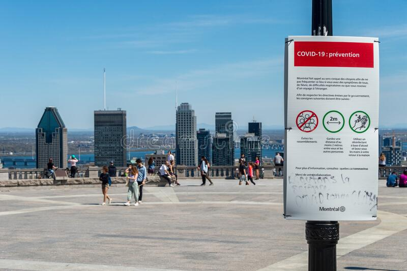Sign showing Covid-19 safety guidelines in Montreal. Montreal, CA - 18 May 2020 : Sign showing french Covid-19 safety guidelines and Montreal skyline in the royalty free stock photography