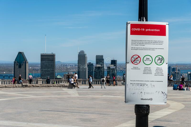 Sign showing Covid-19 safety guidelines in Montreal. Montreal, CA - 18 May 2020 : Sign showing french Covid-19 safety guidelines and Montreal skyline in the royalty free stock photos