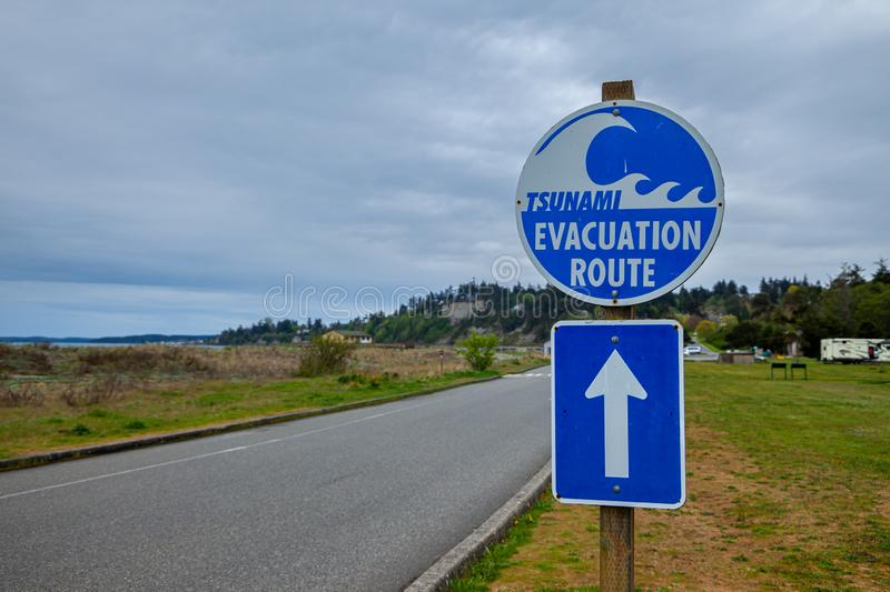 A sign showing a Tsunami Evacuation Route near the Pacific Ocean in Washington. USA stock images