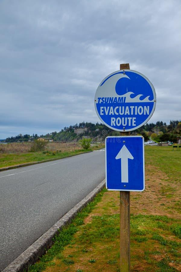 A sign showing a Tsunami Evacuation Route near the Pacific Ocean in Washington. USA stock photography