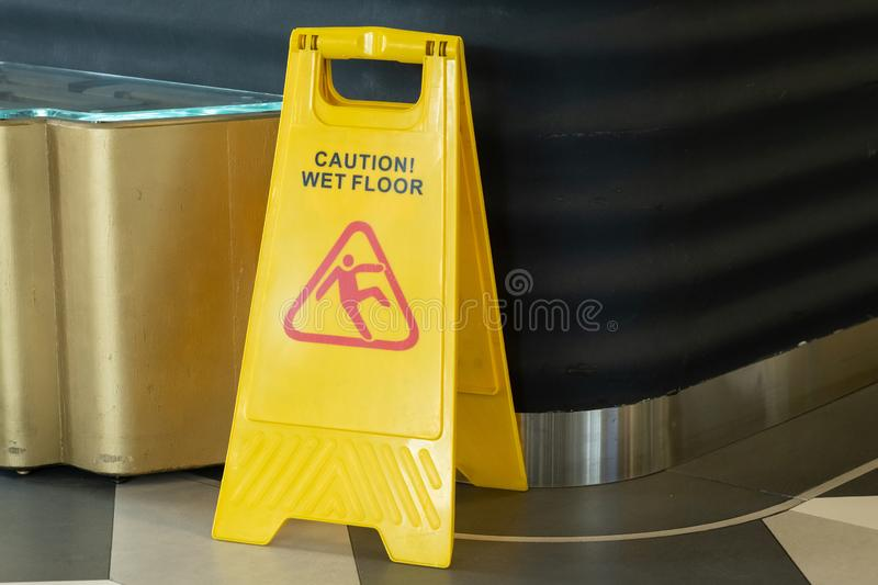 Sign showing warning of caution wet floor outdoors stock images